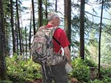 Hiker wearing a Badlands Superday Backpack