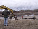 Moose rescue excavator with grapple arrives