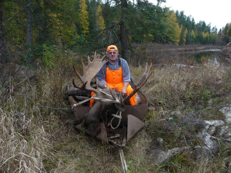 Hunter with his moose