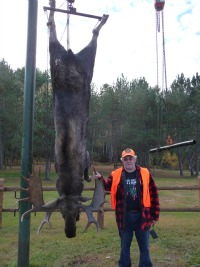 A hunter poses with his moose
