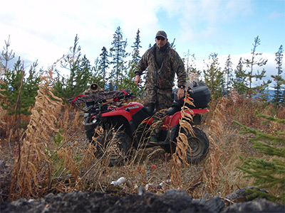 My husband Mark... Moose hunting on his ATV.